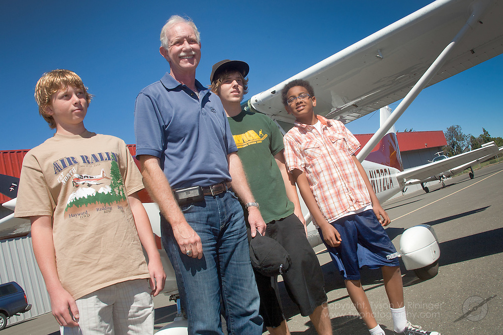 From L-R Thomas Kelbert, Dylan Murphy and Aiden Krebs-Oppenheimer participate in EAA Chapter 29's Young Eagle's Day with Young Eagle's Co-Chairman, Chesley 'Sully' Sullenberger.