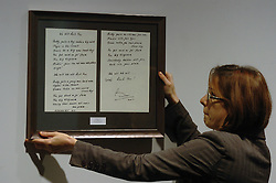 (c) London News Pictures. 06/12/2010. Pictured: A set of handwritten lyrics for the Queen song 'We Will Rock You' penned by Brian May. Lyrics penned by famous songwriters including Sir Paul McCartney, Gary Barlow, Paul Weller and Annie Lennox go on display before the Bonhams' Entertainment Memorabilia Auction on the 15th December with proceeds going to the Teenage Cancer Trust.  Picture caption should read Will Oliver/London News Pictures...