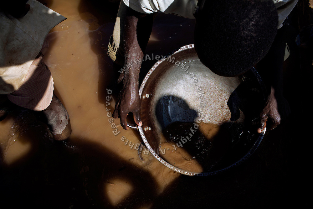Workers are washing ore dust, separating gold sediments from other metals, to later collect it by mixing it with mercury, in an artisanal processing site near Abare, a village affected by lead poisoning due to the unsafe techniques employed for extracting gold, in Zamfara State, Nigeria. The mercury recovered is then burned, revealing unpolished pieces of solid gold. It will be purified in Gusau, where goldsmiths will add sulphuric acid to refine the gold and remove all the impurities. The lead contamination is caused by ingestion and breathing of particles released in the steps to isolate the gold from other metals. This type of lead is soluble in stomach acid and children under-5 are most affected, as they tend to ingest more through their hands by touching the ground, and are developing symptoms often leading to death or serious disabilities.