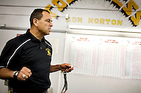 """George Visger, 51, of Grass Valley, Ca., visits the weight room where he remembers awards earned from achieving a weight class, at his former high school, Staggs High School, in Stockton, Ca., on Friday, Oct. 9, 2009. Visger has severe short-term memory loss due to multiple head injuries, however retains a better long-term memory. Visger says there are years that really don't exist. """"I don't really remember them happening."""" Visger survived 9 brain surgeries, caused by concussions incurred throughout his playing career. His first one in 1981, when he turned 23 years old. He keeps daily notes in a yellow notebook and has about three boxes full of notebooks that date back to 1990. ..He works with the Coaches Concussion Clinic, the Brain Injury Association and the Hydrocephaleus Association to increase awareness of concussion-related injuries. ..Visger was a scholarship player for the University of Colorado Buffalos on the 1977 Orange Bowl team, and a 1980 6th round draft pick who played for the San Francisco 49ers, earning a Super Bowl ring for the 1981 Super Bowl Championship."""