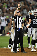 NFL referee Clay Martin (19) makes a penalty call during the Oakland Raiders 2017 NFL week 4 preseason football game against the Seattle Seahawks, Thursday, Aug. 31, 2017 in Oakland, Calif. The Seahawks won the game 17-13. (©Paul Anthony Spinelli)
