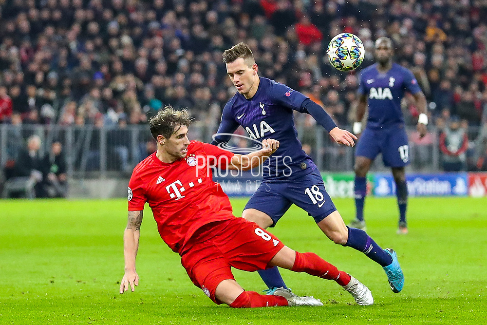 Tottenham Hotspur midfielder Giovani Lo Celso (18) tussles with Bayern Munich defender Javi Martínez (8) during the Champions League match between Bayern Munich and Tottenham Hotspur at Allianz Arena, Munich, Germany on 11 December 2019.
