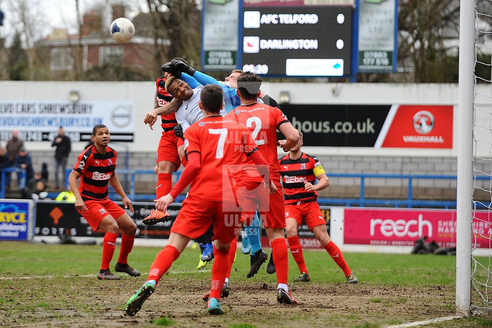 TELFORD COPYRIGHT MIKE SHERIDAN Marcus Dinanga of Telford battles for header during the Vanarama Conference North fixture between AFC Telford United and Darlington at The New Bucks Head on Saturday, March 7, 2020.<br /> <br /> Picture credit: Mike Sheridan/Ultrapress<br /> <br /> MS201920-049
