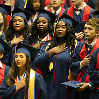 Nettleton High School seniors salute the American Flag as they say the Pladge of Allegiance during their graduation ceremony Saturday morning.