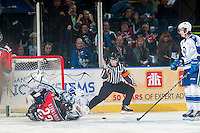 KELOWNA, CANADA - OCTOBER 7: Justin Kirkland #23 of Kelowna Rockets slides into Landon Bow #30 of Swift Current Broncos after scoring the opening goal of the first period on October 7, 2014 at Prospera Place in Kelowna, British Columbia, Canada.  (Photo by Marissa Baecker/Getty Images)  *** Local Caption *** Justin Kirkland; Landon Bow;