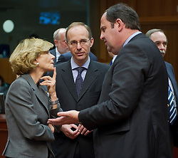 Luc Frieden, Luxembourg's finance minister, center, speaks with Elena Salgado, Spain's finance minister, left, and Josef Proell, Austria's finance minister, right, during the emergency meeting of European Union finance ministers in Brussels, Belgium, on Sunday, May 9, 2010. (Photo © Jock Fistick)