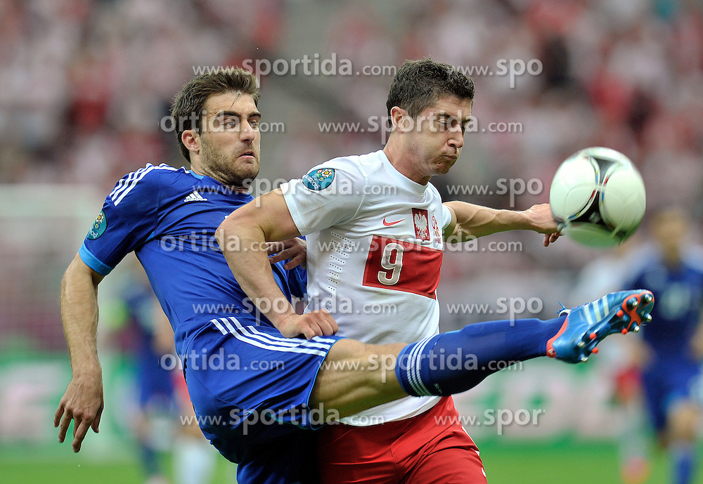 (L) Sokratis Papastathopoulos of Greece (nr19) fights for the ball with (R) Poland's Robert Lewandowski (nr09) during their the UEFA EURO 2012 Group A football match between Poland and Greece at National Stadium in Warsaw on June 08, 2012....Poland, Warsaw, June 08, 2012..Picture also available in RAW (NEF) or TIFF format on special request...For editorial use only. Any commercial or promotional use requires permission...Photo by © Adam Nurkiewicz / Mediasport