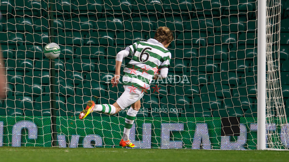 GLASGOW, SCOTLAND - Wednesday, December 7, 2011: Glasgow Celtic's Filip Twardzik scores the first goal against Olympique de Marseille during the NextGen Series Group 1 match at Celtic Park. (Pic by David Rawcliffe/Propaganda)