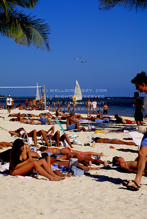 Image of sunbathers on Smathers Beach in Key West, Florida, American Southeast