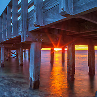 New England sunset photography of the Duxbury Bridge aka Powder Point Bridge in Duxbury, MA. While not the longest and oldest wooden bridge in the world any more, it is still impressive and an adventure to cross over to Duxbury Beach. <br />