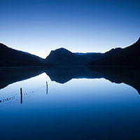 Reflections of mountains in a lake at Buttermere, Lake District, Cumbria, England