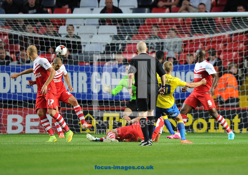 Tal Ben Haim of Charlton Athletic  cannot stop Jamie Ward of Derby County (10) scoring the equaliser during the Sky Bet Championship match at The Valley, London<br /> Picture by Alan Stanford/Focus Images Ltd +44 7915 056117<br /> 19/08/2014