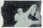deteriorating glass plate of mother holding baby