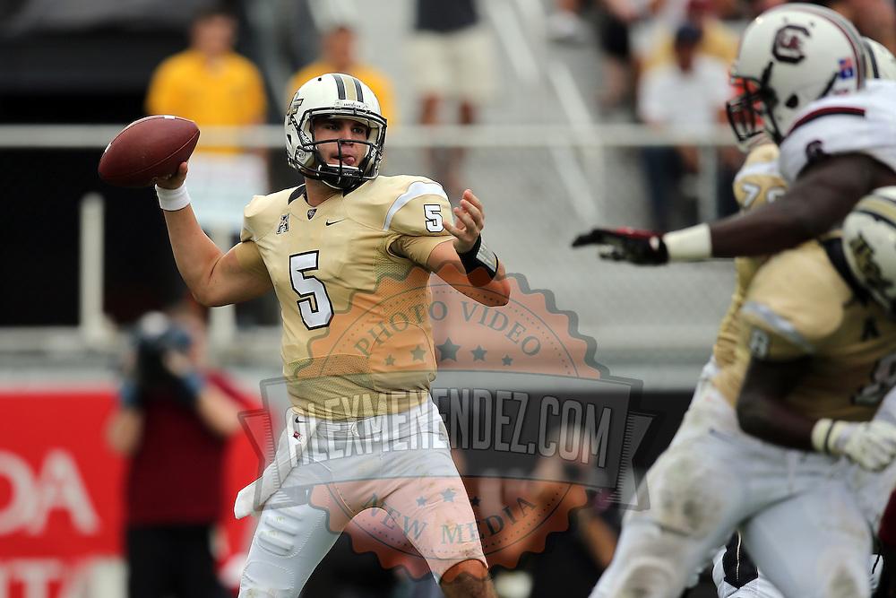 UCF Knights quarterback Blake Bortles (5) passes during an NCAA football game between the South Carolina Gamecocks and the Central Florida Knights at Bright House Networks Stadium on Saturday, September 28, 2013 in Orlando, Florida. (AP Photo/Alex Menendez)