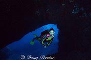 diver enters lava tube, Kaupulehu, Kona, Hawaii ( the Big Island), United States ( Central Pacific Ocean ) MR 287