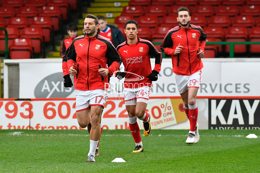Marc Richards (17) of Swindon Town and other players warming up before the EFL Sky Bet League 2 match between Swindon Town and Yeovil Town at the County Ground, Swindon, England on 10 April 2018. Picture by Graham Hunt.