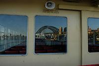 Harbour bridge reflection in a ferry window, Sydney , Australia. January 2nd-11th 2007