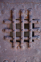 Close-up of an old iron window grating in a Norman building in Mont St. Michel.