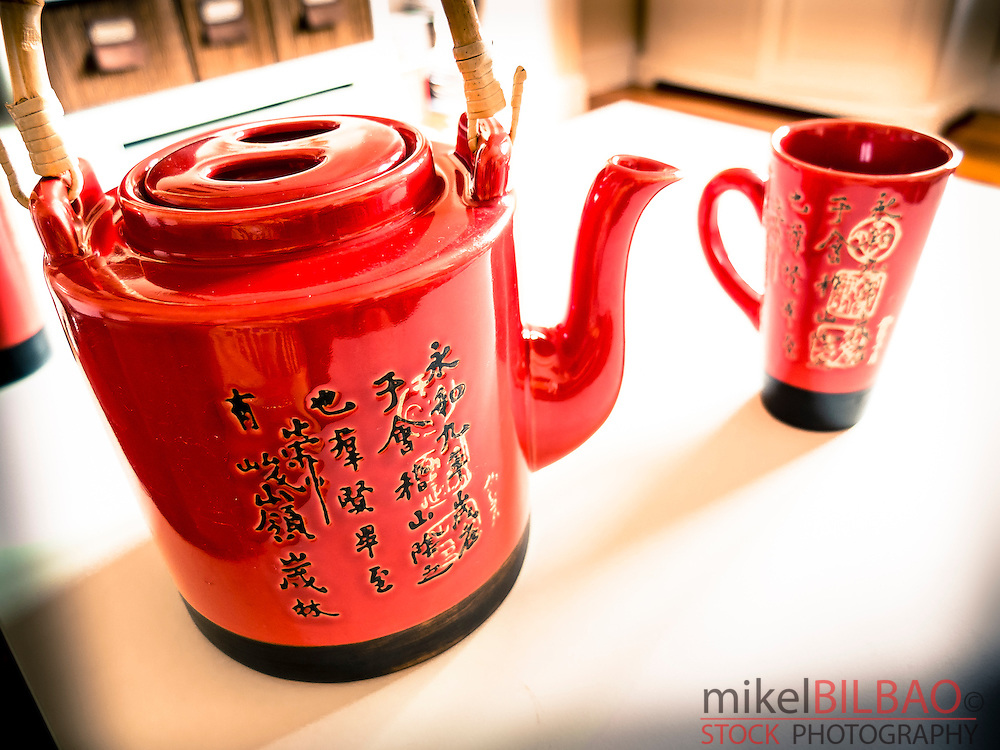 red teapot with chinese script