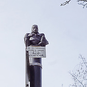 London,England,UK : 10th April 2016 : A gorilla hanging on top of a lamp post part of the 120 metre stretch of railway arches of 'Endangered 13' at Ackroyd Drive Sponsor by Tower Hamlets council in London. Photo by See Li