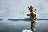 Captain Justin Waters fishes for searun cutthroat trout in the waters of Hood Canal in Washington State. This type of sea trout is only found in the waters of the Puget Sound due to a lack of migratory behavior.