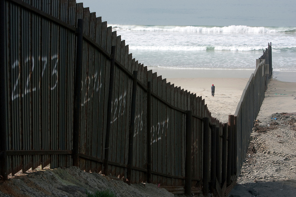 The fence between the Imperial Beach section of San Diego, California and Tijuana, Mexico. Please contact Todd Bigelow directly with your licensing requests.