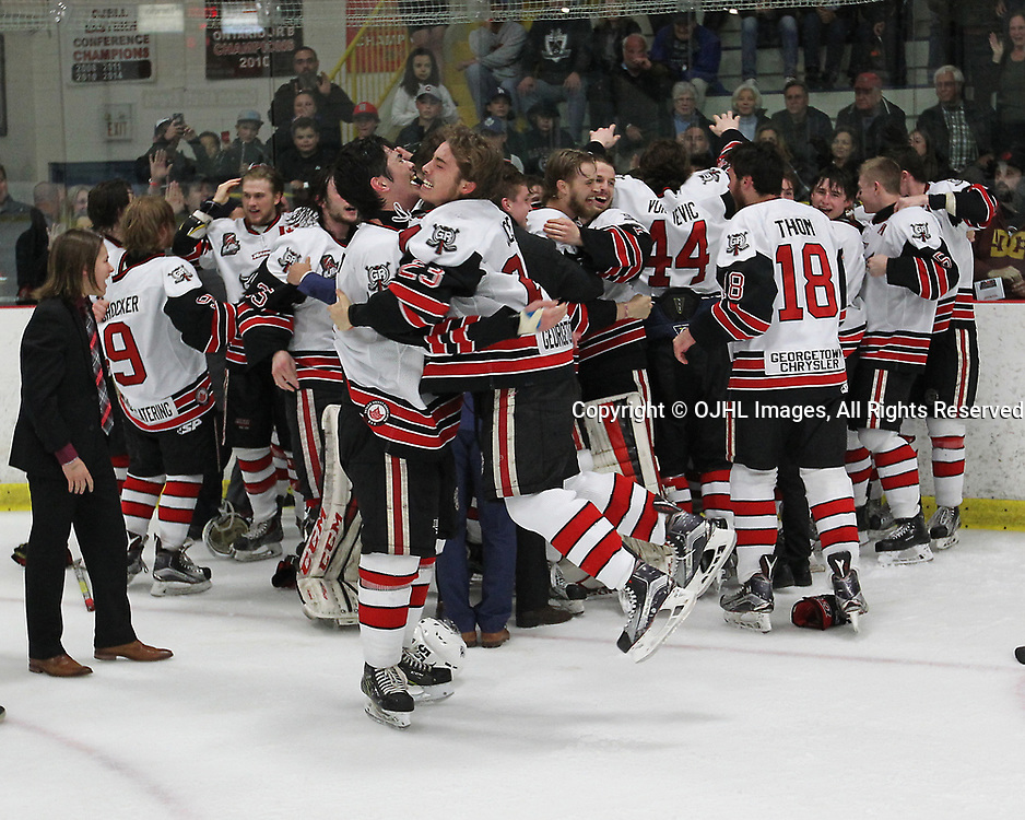 GEORGETOWN, ON  - APR 26,  2017: Ontario Junior Hockey League, Championship Series. Georgetown Raiders vs the Trenton Golden Hawks in Game 7 of the Buckland Cup Final. Georgetown Raiders players celebrate the 2017 Buckland Cup Championship win.<br /> (Photo by Tim Bates / OJHL Images)
