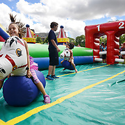 Eva Duma, 7, steers an inflatable horse to the finish line on Sunday at Victoria Park during KidsPark festivities. Dozens of local sport and recreation, culture and science organizations offer free activities during the day.<br /> <br /> IAN STEWART / SPECIAL TO THE RECORD