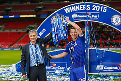 Chelsea Manager Jose Mourinho and ,goalscorer John Terry hold the trophy after winning the Capital One Cup Final - Photo mandatory by-line: Rogan Thomson/JMP - 07966 386802 - 01/03/2015 - SPORT - FOOTBALL - London, England - Wembley Stadium - Chelsea v Tottenham Hotspur - Capital One Cup Final.