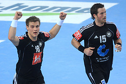 Michael Kraus (18) and Torsten Jansen (15) of Germany celebrate during 21st Men's World Handball Championship preliminary Group C match between FYR Macedonia and Germany, on January 21, 2009, in Arena Varazdin, Varazdin, Croatia. (Photo by Vid Ponikvar / Sportida)