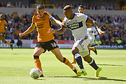 Middlesbrough striker Britt Assombalonga (9) battles with Wolverhampton Wanderers midfielder Conor Coady (16) 0-0 during the EFL Sky Bet Championship match between Wolverhampton Wanderers and Middlesbrough at Molineux, Wolverhampton, England on 5 August 2017. Photo by Alan Franklin.