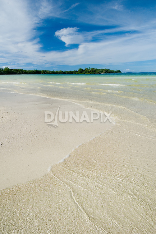 The inlet to the Kerehikapa Island lagoon, a five-minute walk from the Arnavons Field Station, presents an ever-changing display of coral sand washed by gentle waves.