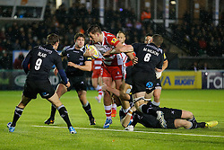 Gloucester Inside Centre Mark Atkinson is tackled by Flanker Mark Wilson and Newcastle Fly-Half Rory Clegg - Photo mandatory by-line: Rogan Thomson/JMP - 07966 386802 - 21/11/2014 - SPORT - RUGBY UNION - Newcastle upon Tyne, England - Kingston Park - Newcastle Falcons v Gloucester Rugby - Aviva Premiership.