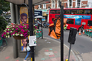 An aerial view of covered traffic lights and advertising at the corner of Coldharbour Lane and Denmark Hill in Camberwell, Southwark, on 18th June 2019, in London, England.