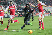 Marvin Emnes (Blackburn Rovers) runs to collect the ball and keep the attack alive as Stephen Kelly (Rotherham United) and Semi Ajayi (Rotherham United) watch on during the EFL Sky Bet Championship match between Rotherham United and Blackburn Rovers at the AESSEAL New York Stadium, Rotherham, England on 11 February 2017. Photo by Mark P Doherty.