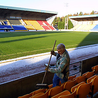 A clear pitch at McDermid Park, Perth thanks to the undersoil heating, hopefully tommorrow's game against Hearts will go ahead. The ground staff are pictured clearing the snow from the stands<br />