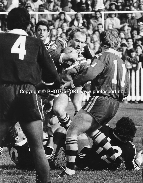 Kiwi players attempt to stop Wally Lewis (Aus) on the burst. Kiwis v Austraila. Date Unknown, Rugby League archival. Norman Smith/PHOTOSPORT