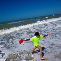 NAPLES, FL -- March 13, 2010 -- Bethany Latham, 9, of Bethlehem, Pennsylvania, runs through the surf as she collects clams during the Nature's Wonders program at The Ritz-Carlton in Naples, Fla., on Saturday, March 13, 2010.  The three hour programs let kids experience a more involved, educational nature program while parents get free time to enjoy themselves sans kids.