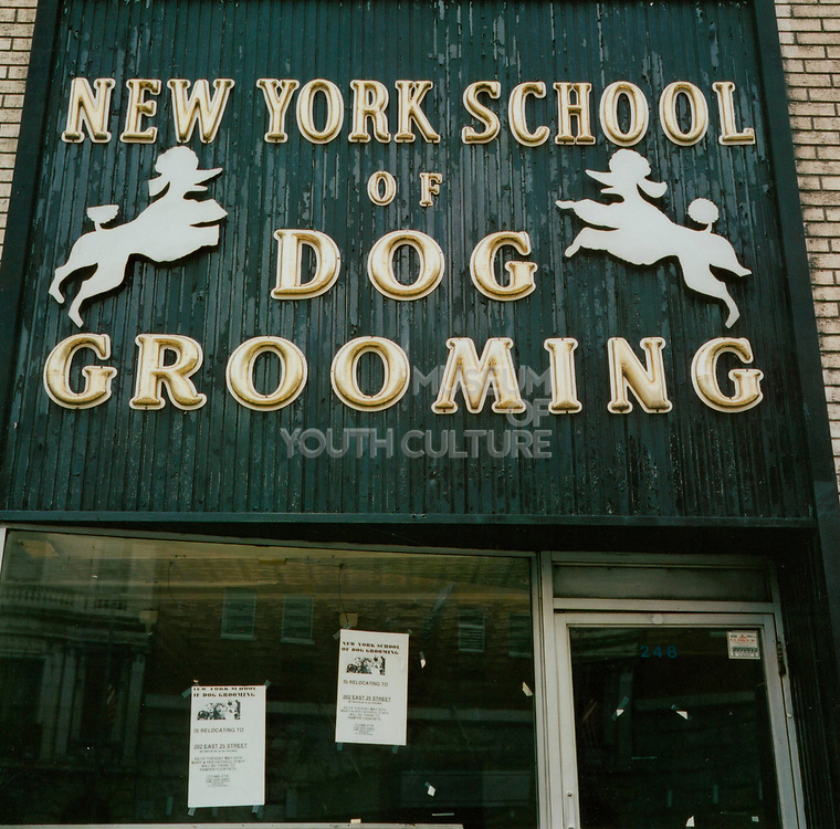 "Shop front sign ""New York school of dog grooming"" USA"