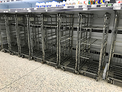 © Licensed to London News Pictures. 27/02/2018. London, UK. Empty milk shelves at Asda supermarket in Gillingham, Kent on the evening of February 26, 2018 as a cold front from Russia , named 'The Beat From The East', hits the UK. Photo credit: Graham Long/LNP