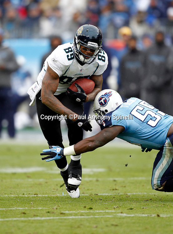 Jacksonville Jaguars tight end Marcedes Lewis (89) catches a pass while trying to avoid a tackle attempt by Tennessee Titans linebacker Stephen Tulloch (55) during the NFL week 13 football game on Sunday, December 5, 2010 in Nashville, Tennessee. The Jaguars won the game 17-6. (©Paul Anthony Spinelli)