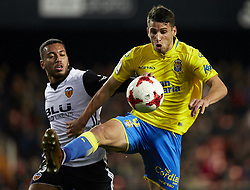 January 9, 2018 - Valencia, Valencia, Spain - Calleri (R) of UD Las Palmas controls the ball next to Ruben Vezo of Valencia CF during the Copa del Rey Round of 16, second leg game between Valencia CF and Las Palmas at Mestalla on January 9, 2018 in Valencia, Spain  (Credit Image: © David Aliaga/NurPhoto via ZUMA Press)