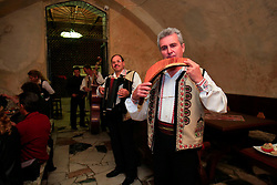 ROMANIA BRASOV 27OCT12 - Folklore musicians welcome guests with a pan flute and an accordeon at the Casa Fischer restaurant in Brasov city centre.....jre/Photo by Jiri Rezac / WSPA....© Jiri Rezac 2012