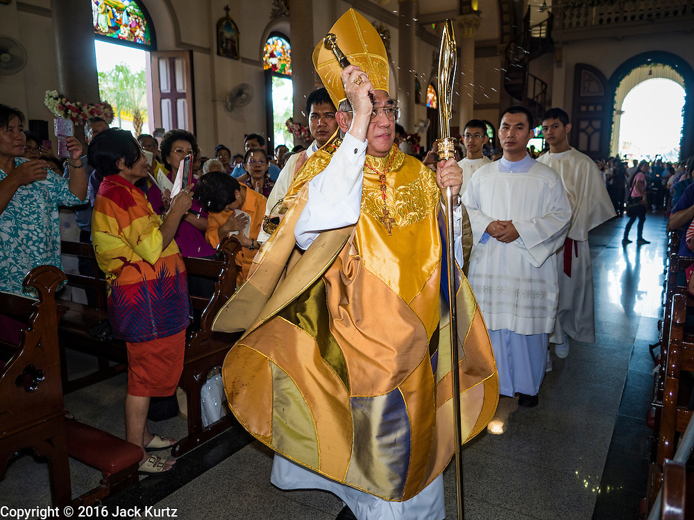 18 SEPTEMBER 2016 - BANGKOK, THAILAND:   FRANCIS XAVIER KRIENGSAK, the Archbishop of Bangkok, sprinkles parishioners with holy water during the church's 100th anniversary mass. Santa Cruz Church was establised in 1769 to serve Portuguese soldiers in the employ of King Taksin, who reestablished the Siamese (Thai) empire after the Burmese sacked the ancient Siamese capital of Ayutthaya. The church was one of the first Catholic churches in Bangkok and is one of the most historic Catholic churches in Thailand. The first sanctuary was a simple wood and thatch structure and burned down in the 1800s. The church is in its third sanctuary and was designed in a Renaissance / Neo-Classical style. It was consecrated in September, 1916. The church, located on the Chao Phraya River, serves as a landmark for central Bangkok.      PHOTO BY JACK KURTZ