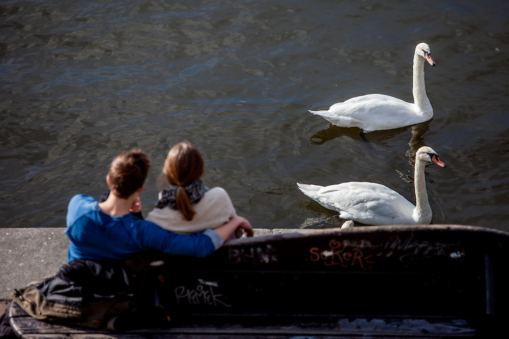 "People are resting on the ""Moldau"" riverside in Prague."