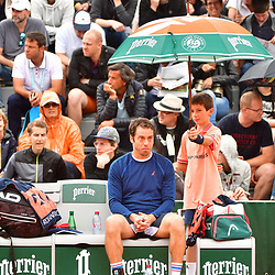 Paolo Lorenzi of Italy waits in the rain for his opponent to arrive during Day 3 of the French Open 2018 on May 29, 2018 in Paris, France. (Photo by Dave Winter/Icon Sport)