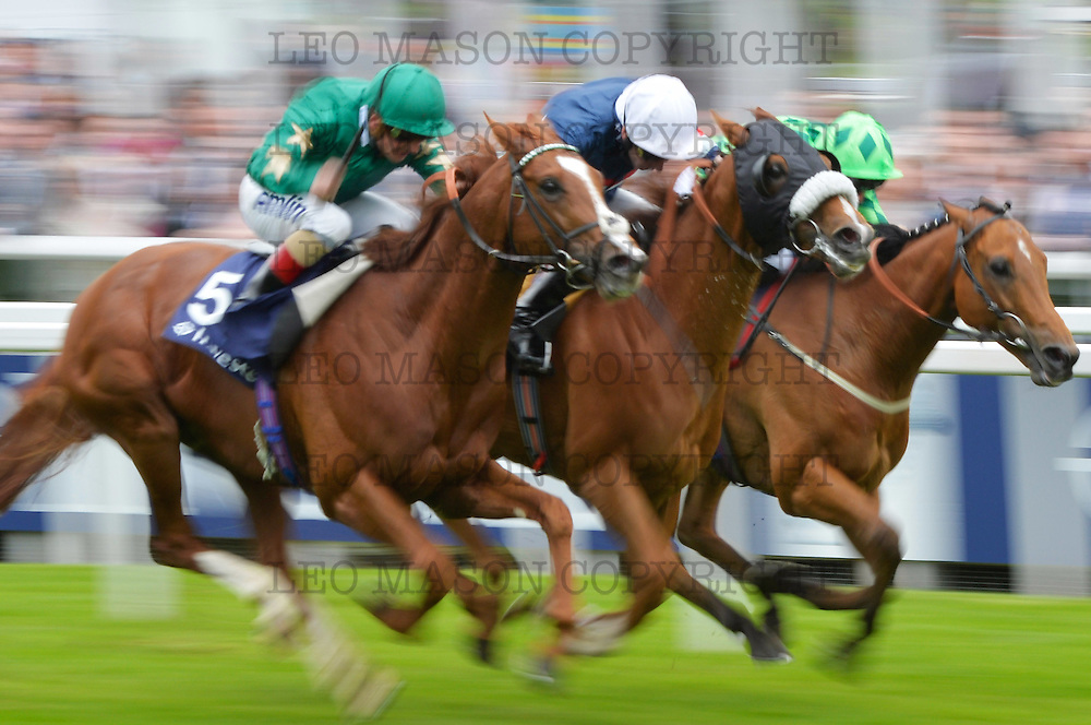 03.06.2016  Investec Ladies Day OAKS meeting at Epsom racecourse UK  The Investec Diomond Stakes won in a photo finish by Tullius IRE (centre) ridden by Jimmy Fortune<br /> Media Event ID: 640940641