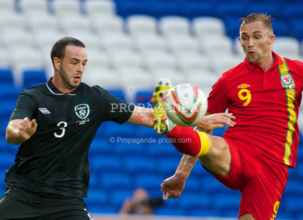 CARDIFF, WALES - Wednesday, August 14, 2013: Wales' Jack Collison in action against Republic of Ireland's Marc Wilson during an International Friendly at the Cardiff City Stadium. (Pic by David Rawcliffe/Propaganda)