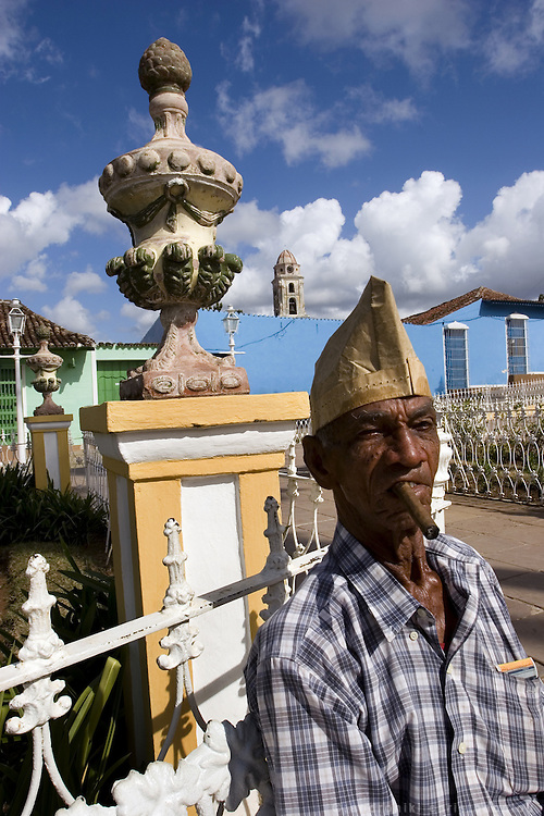 Man smoking Cuban cigar in Trinidad, a popular tourist destination of Cienfuefos province - CUBA