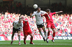 CARDIFF, WALES - SATURDAY MARCH 26th 2005: Wales' Carl Robinson and John Hartson challenge Austria's Anton Ehmann (L) and Emanuel Pogatez during the Wold Cup Qualifying match at the Millennium Stadium. (Pic by David Rawcliffe/Propaganda)